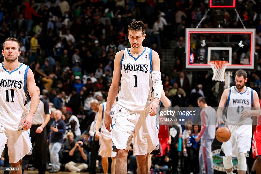 Alexey Shved #1 and Jose Juan Barea #11 of the Minnesota Timberwolves walk off the court following their team's loss to the Houston Rockets on December 26, 2012 at Target Center in Minneapolis, Minnesota.