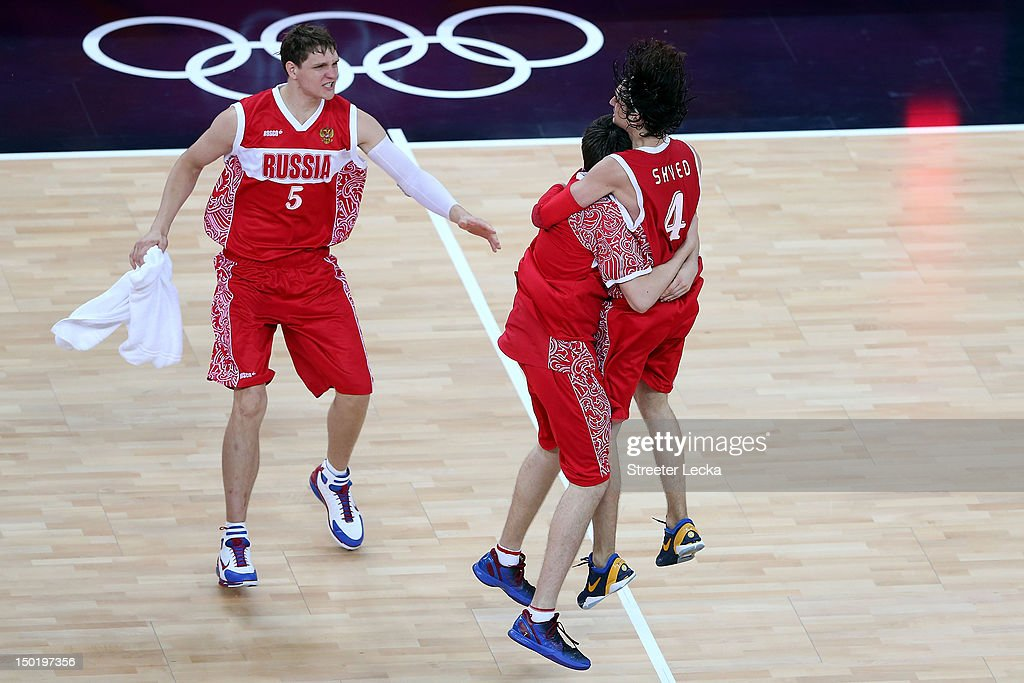 <a gi-track='captionPersonalityLinkClicked' href=/galleries/search?phrase=Alexey+Shved&family=editorial&specificpeople=5557761 ng-click='$event.stopPropagation()'>Alexey Shved</a> #4 of Russia and team mate <a gi-track='captionPersonalityLinkClicked' href=/galleries/search?phrase=Timofey+Mozgov&family=editorial&specificpeople=3949705 ng-click='$event.stopPropagation()'>Timofey Mozgov</a> #5 of Russia celebrate winning the Men's Basketball bronze medal game between Russia and Argentina on Day 16 of the London 2012 Olympics Games at North Greenwich Arena on August 12, 2012 in London, England.