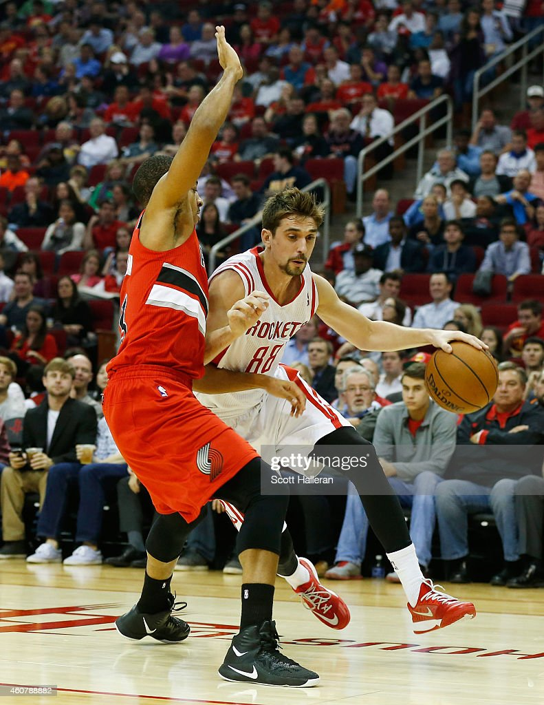 Alexey Shved #88 of the Houston Rockets dribbles with the basketball in front of <a gi-track='captionPersonalityLinkClicked' href=/galleries/search?phrase=C.J.+McCollum&family=editorial&specificpeople=7688223 ng-click='$event.stopPropagation()'>C.J. McCollum</a> #3 of the Portland Trail Blazers during their game at the Toyota Center on December 22, 2014 in Houston, Texas.