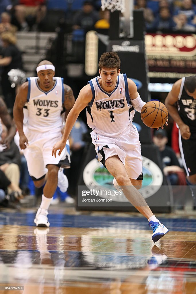 <a gi-track='captionPersonalityLinkClicked' href=/galleries/search?phrase=Alexey+Shved&family=editorial&specificpeople=5557761 ng-click='$event.stopPropagation()'>Alexey Shved</a> #1 of the Minnesota Timberwolves brings the ball up court against the Minnesota Timberwolves on March 12, 2013 at Target Center in Minneapolis, Minnesota.