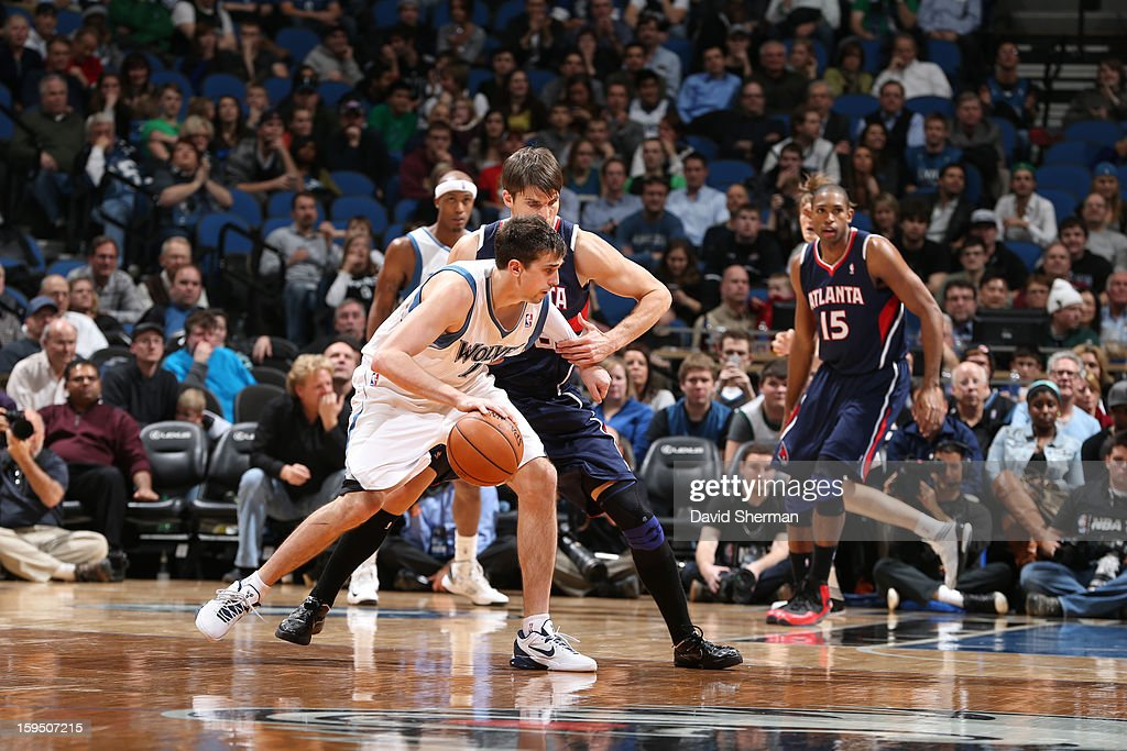 Alexey Shved #1 of the Minnesota Timberwolves controls the ball against Kyle Korver #26 of the Atlanta Hawks on January 8, 2013 at Target Center in Minneapolis, Minnesota.