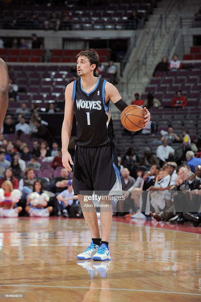 <a gi-track='captionPersonalityLinkClicked' href=/galleries/search?phrase=Alexey+Shved&family=editorial&specificpeople=5557761 ng-click='$event.stopPropagation()'>Alexey Shved</a> #1 of the Minnesota Timberwolves dribbles the ball while looking to pass against the Detroit Pistons during the game on March 26, 2013 at The Palace of Auburn Hills in Auburn Hills, Michigan.