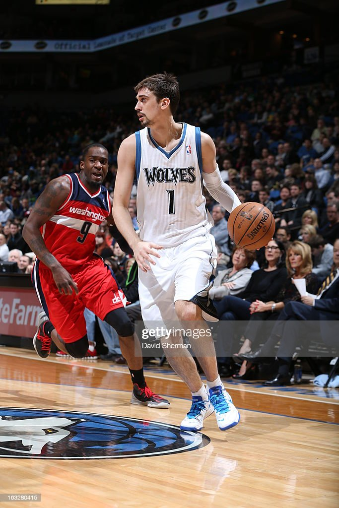 Alexey Shved #1 of the Minnesota Timberwolves drives against Martell Webster #9 of the Washington Wizards on March 6, 2013 at Target Center in Minneapolis, Minnesota.