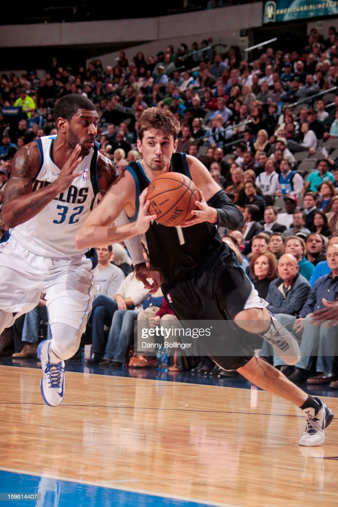 Alexey Shved #1 of the Minnesota Timberwolves drives against O.J. Mayo #32 of the Dallas Mavericks on January 14, 2013 at the American Airlines Center in Dallas, Texas.