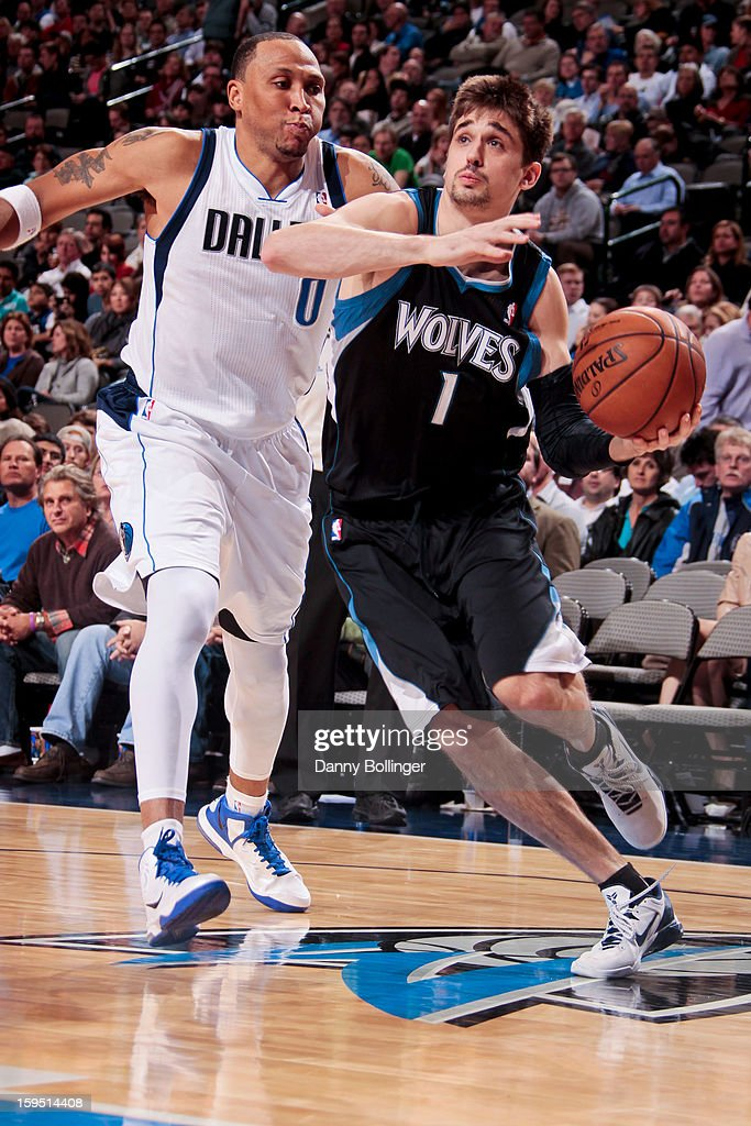 Alexey Shved #1 of the Minnesota Timberwolves drives against Shawn Marion #0 of the Dallas Mavericks on January 14, 2013 at the American Airlines Center in Dallas, Texas.