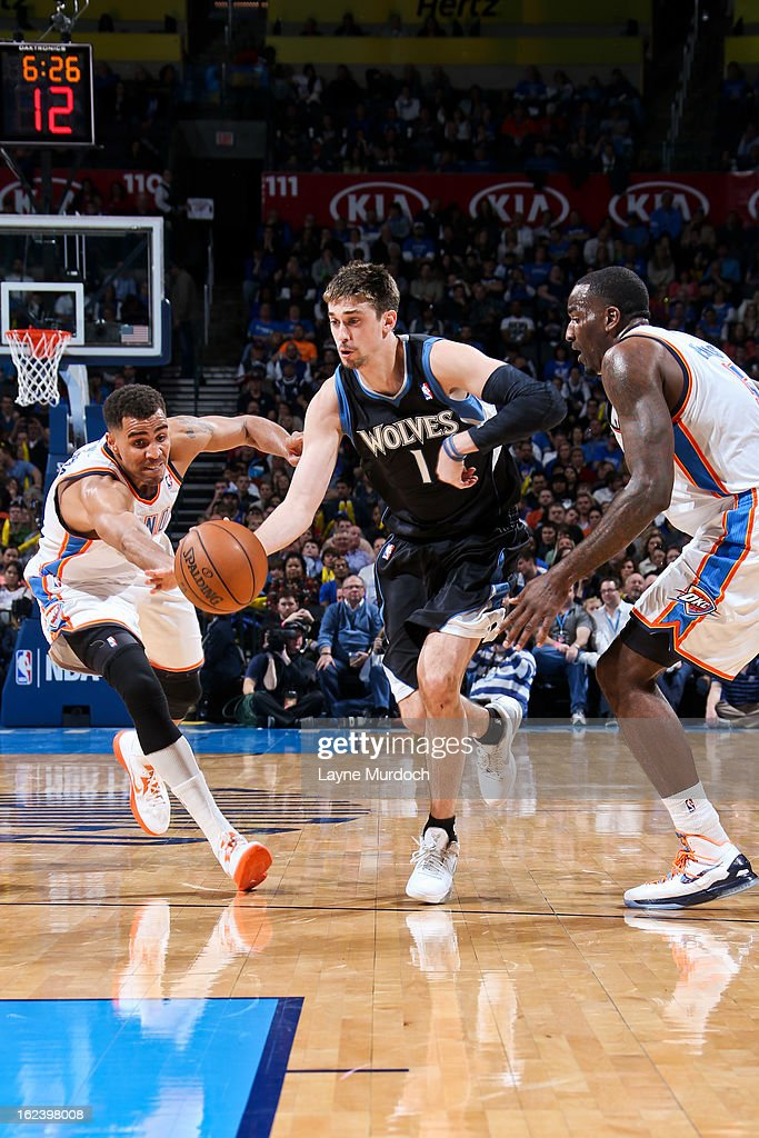 Alexey Shved #1 of the Minnesota Timberwolves drives against Thabo Sefolosha #2 and Kendrick Perkins #5 of the Oklahoma City Thunder on February 22, 2013 at the Chesapeake Energy Arena in Oklahoma City, Oklahoma.
