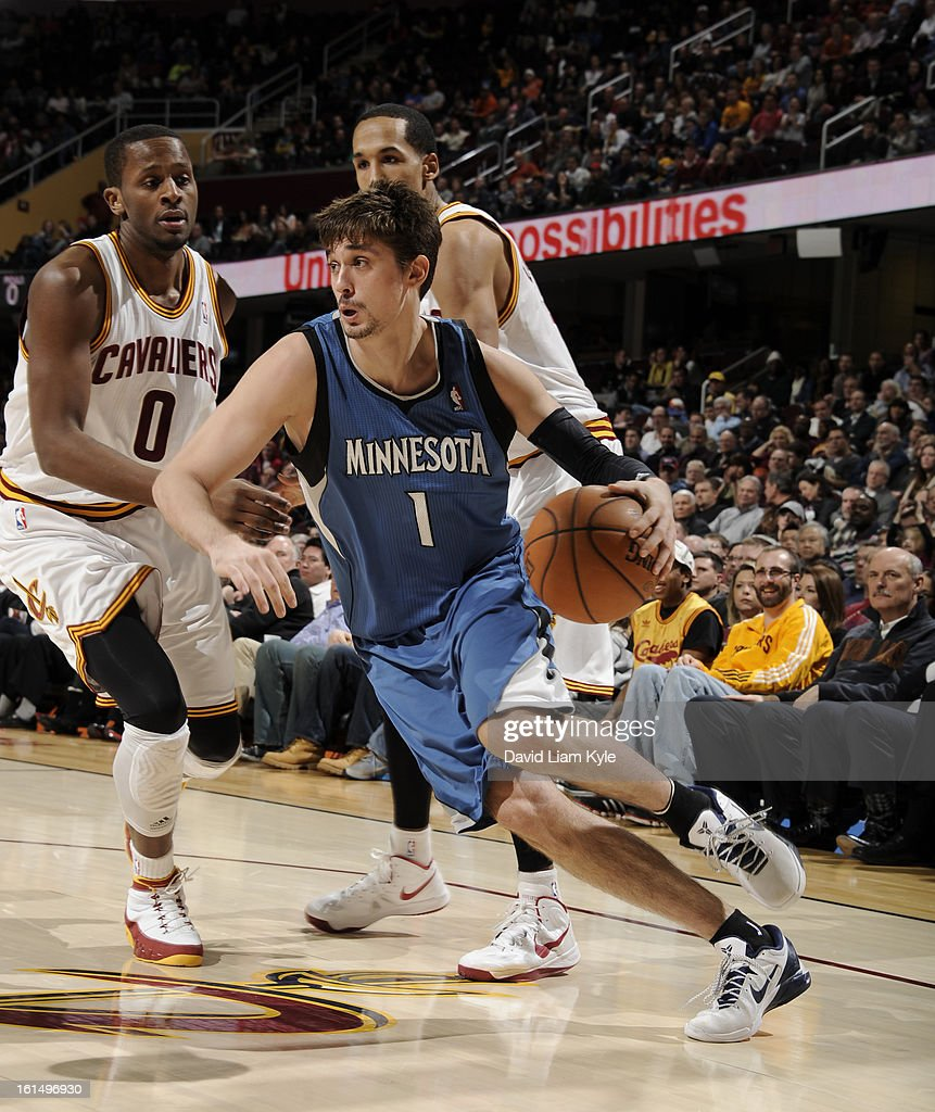 Alexey Shved #1 of the Minnesota Timberwolves drives to the basket against C.J. Miles #0 and Shaun Livingston #14 of the Cleveland Cavaliers at The Quicken Loans Arena on February 11, 2013 in Cleveland, Ohio.