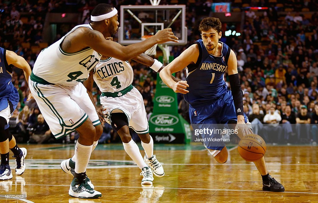 Alexey Shved #1 of the Minnesota Timberwolves drives to the basket in front of Chris Wilcox #44 of the Boston Celtics during the game on December 5, 2012 at TD Garden in Boston, Massachusetts.