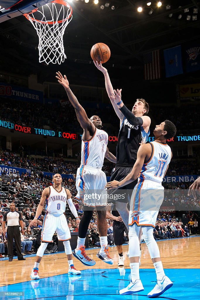 Alexey Shved #1 of the Minnesota Timberwolves drives to the basket against Kendrick Perkins #5 and Jeremy Lamb #11 of the Oklahoma City Thunder on February 22, 2013 at the Chesapeake Energy Arena in Oklahoma City, Oklahoma.