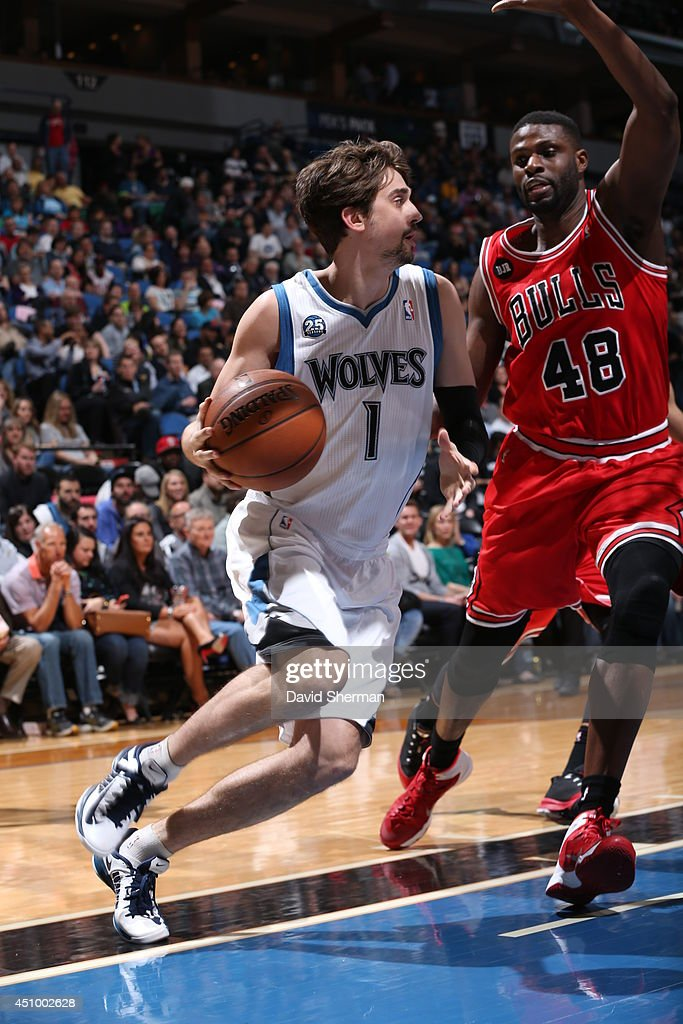 Alexey Shved #1 of the Minnesota Timberwolves handles the ball against the Chicago Bulls during the game on April 9, 2014 at Target Center in Minneapolis, Minnesota.