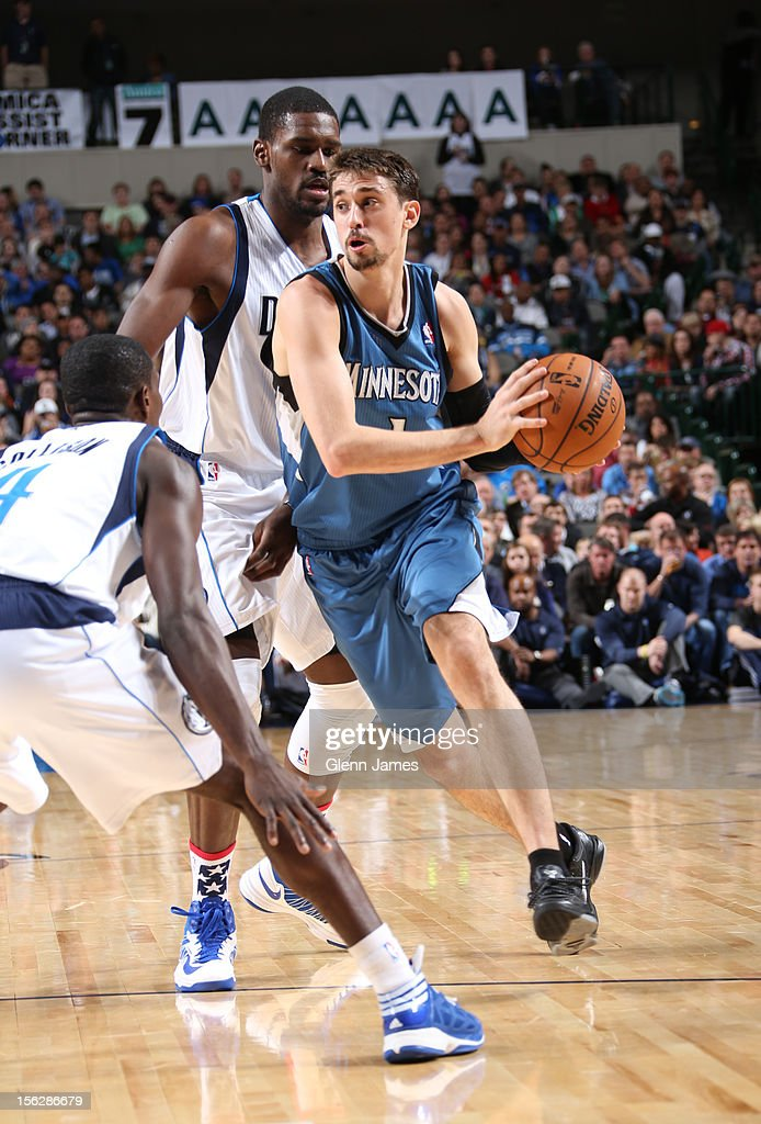 Alexey Shved #1 of the Minnesota Timberwolves looks to pass out of the double team against Darren Collison #4 and Bernard James #5 of the Dallas Mavericks on November 12, 2012 at the American Airlines Center in Dallas, Texas.