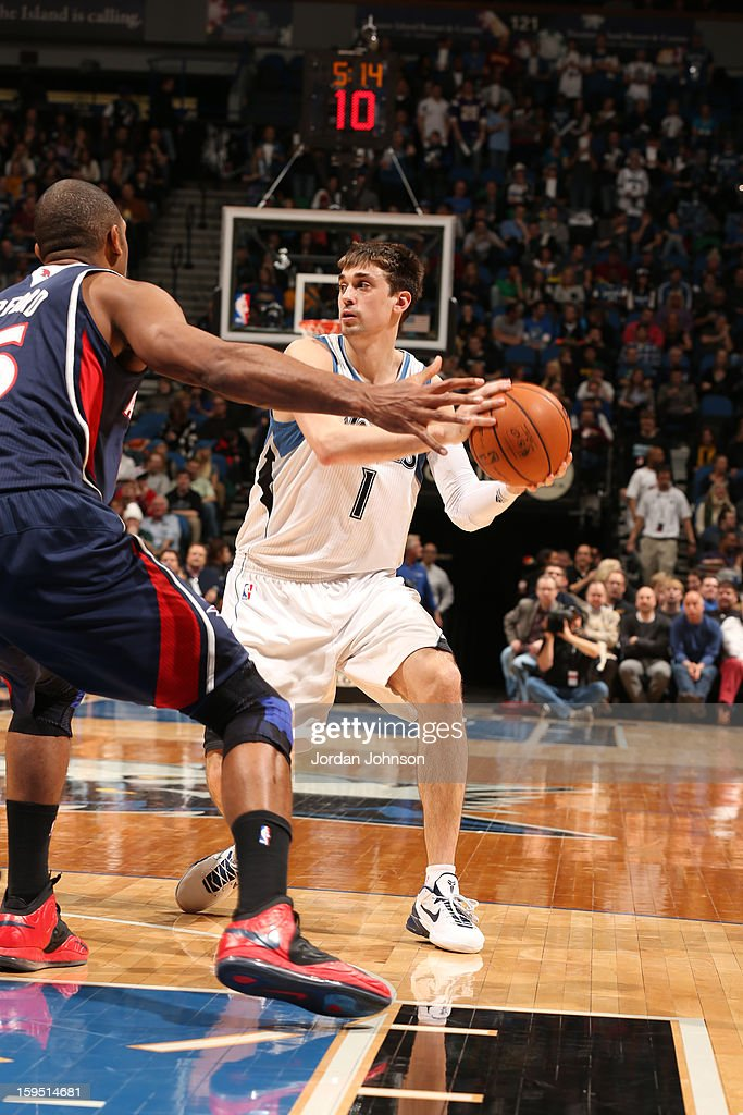 Alexey Shved #1 of the Minnesota Timberwolves looks to pass the ball against <a gi-track='captionPersonalityLinkClicked' href=/galleries/search?phrase=Al+Horford&family=editorial&specificpeople=699030 ng-click='$event.stopPropagation()'>Al Horford</a> #15 of the Atlanta Hawks on January 8, 2013 at Target Center in Minneapolis, Minnesota.