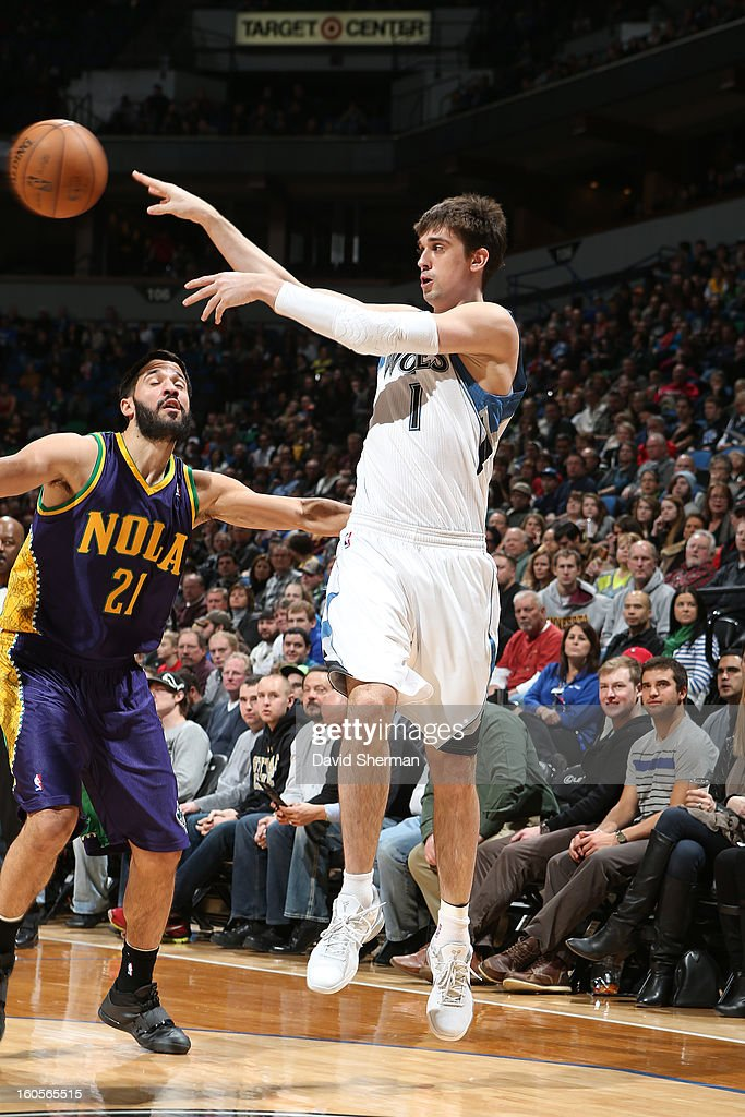 Alexey Shved #1 of the Minnesota Timberwolves makes a pass against Greivis Vasquez #21 of the New Orleans Hornets on February 2, 2013 at Target Center in Minneapolis, Minnesota.