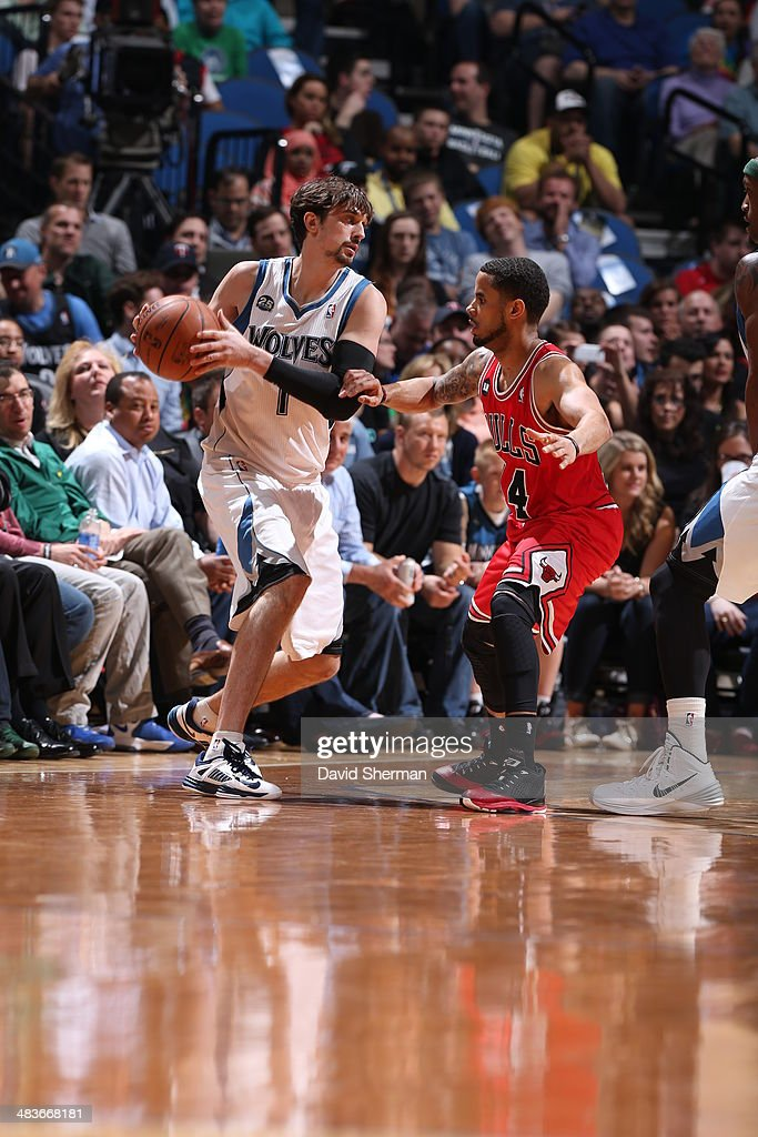 Alexey Shved #1 of the Minnesota Timberwolves passes the ball against the Chicago Bulls during the game on April 9, 2014 at Target Center in Minneapolis, Minnesota.