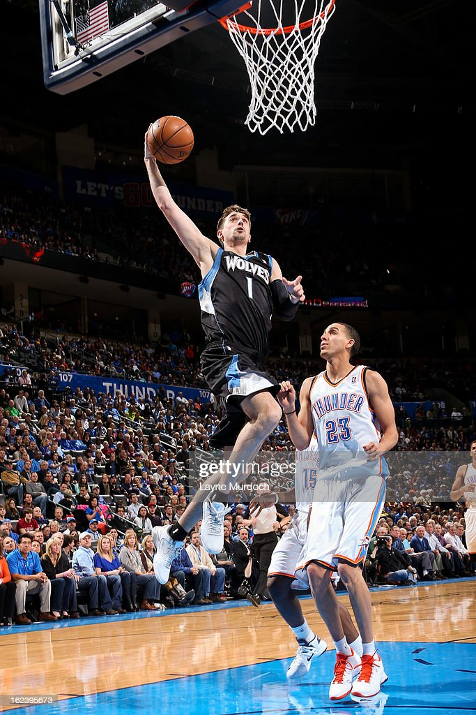 Alexey Shved #1 of the Minnesota Timberwolves rises for a dunk against Kevin Martin #23 of the Oklahoma City Thunder on February 22, 2013 at the Chesapeake Energy Arena in Oklahoma City, Oklahoma.