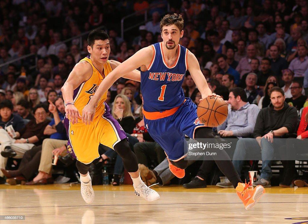Alexey Shved #1 of the New York Knicks drives past Jeremy Lin #17 of the Los Angeles Lakers at Staples Center on March 12, 2015 in Los Angeles, California. The Knicks won 101-94.