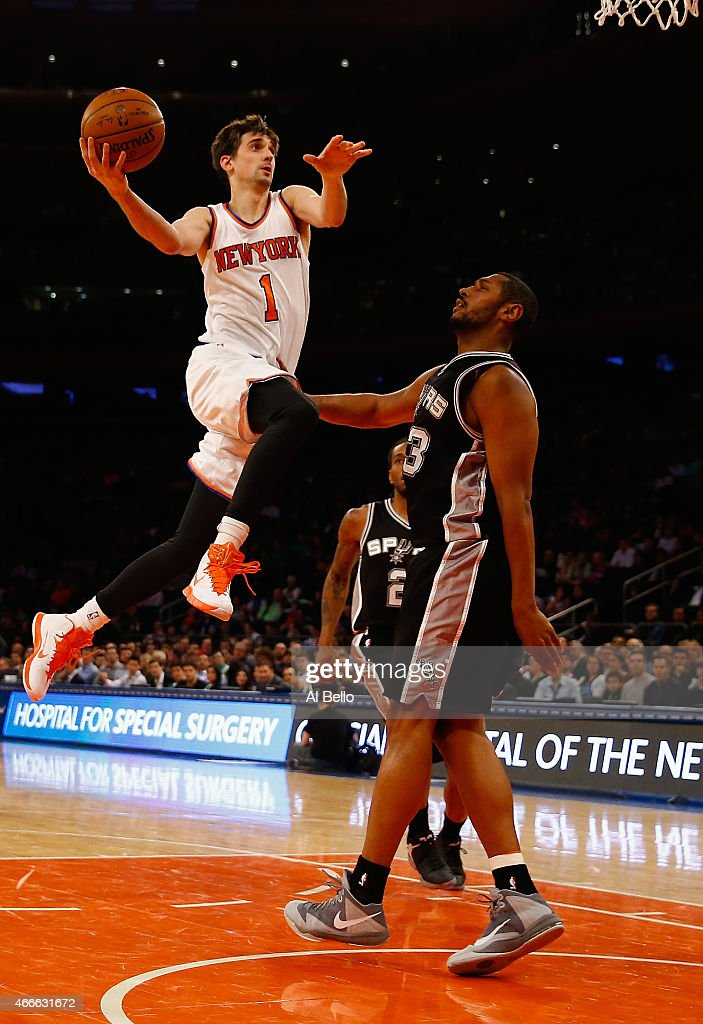 <a gi-track='captionPersonalityLinkClicked' href=/galleries/search?phrase=Alexey+Shved&family=editorial&specificpeople=5557761 ng-click='$event.stopPropagation()'>Alexey Shved</a> #1 of the New York Knicks shoots against <a gi-track='captionPersonalityLinkClicked' href=/galleries/search?phrase=Boris+Diaw&family=editorial&specificpeople=201505 ng-click='$event.stopPropagation()'>Boris Diaw</a> #33 of the San Antonio Spurs during their game at Madison Square Garden on March 17, 2015 in New York City.