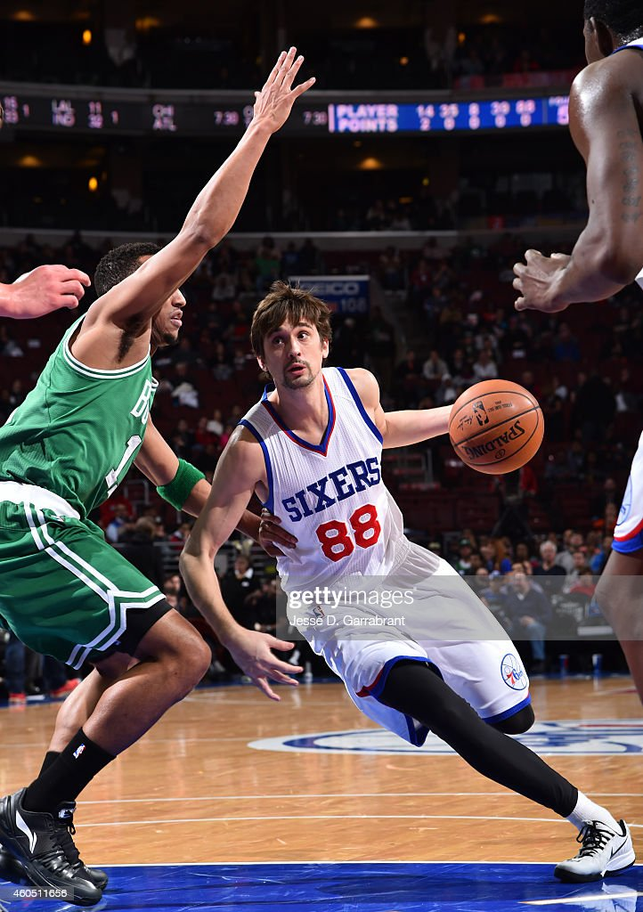 <a gi-track='captionPersonalityLinkClicked' href=/galleries/search?phrase=Alexey+Shved&family=editorial&specificpeople=5557761 ng-click='$event.stopPropagation()'>Alexey Shved</a> #88 of the Philadelphia 76ers drives to the basket against the Boston Celtics on December 15, 2014 at Wells Fargo Center in Philadelphia, PA.