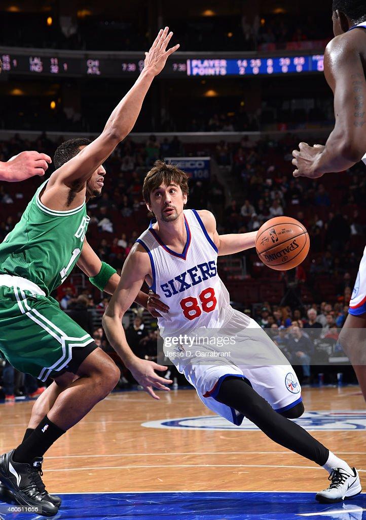 Alexey Shved #88 of the Philadelphia 76ers drives to the basket against the Boston Celtics on December 15, 2014 at Wells Fargo Center in Philadelphia, PA.