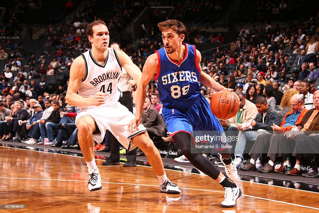 <a gi-track='captionPersonalityLinkClicked' href=/galleries/search?phrase=Alexey+Shved&family=editorial&specificpeople=5557761 ng-click='$event.stopPropagation()'>Alexey Shved</a> #88 of the Philadelphia 76ers handles the ball against the Brooklyn Nets during the game on October 20, 2014 at Barclays Center in Brooklyn, New York.