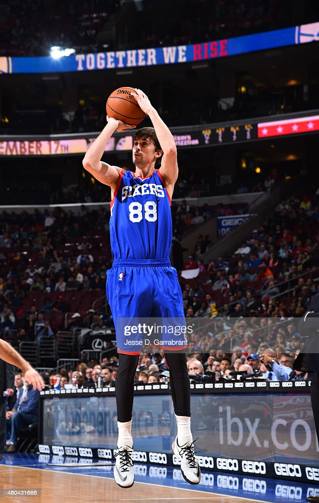 <a gi-track='captionPersonalityLinkClicked' href=/galleries/search?phrase=Alexey+Shved&family=editorial&specificpeople=5557761 ng-click='$event.stopPropagation()'>Alexey Shved</a> #88 of the Philadelphia 76ers shoots the ball against the Memphis Grizzlies on December 13, 2014 at Wells Fargo Center in Philadelphia, PA.