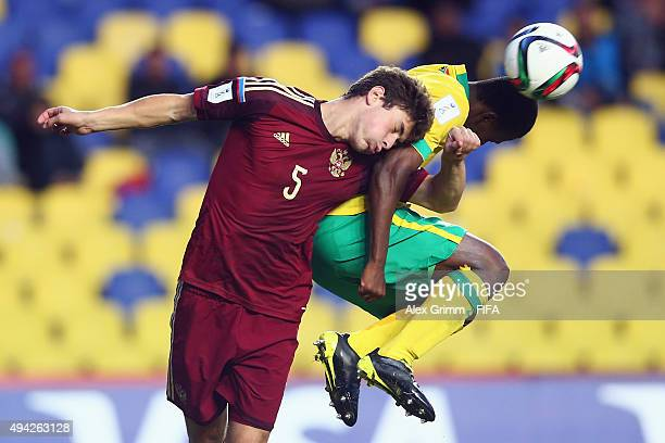 Alexey Tataev of Russia jumps for a header with Luvuyo Mkatshana of South Africa during the FIFA U17 World Cup Chile 2015 Group E match between...