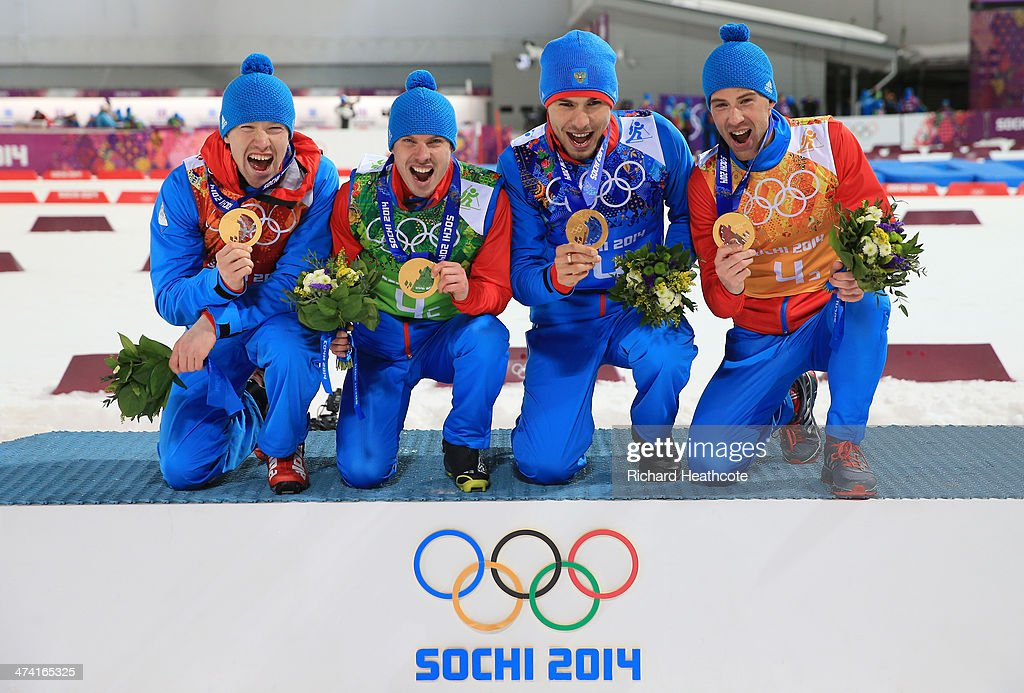 Alexey Volkov, Evgeny Ustyugov, Dmitry Malyshko and Anton Shipulin of Russia celebrate on the podium during flower ceremony for the Men's 4 x 7.5 km Relay during day 15 of the Sochi 2014 Winter Olympics at Laura Cross-country Ski & Biathlon Center on February 22, 2014 in Sochi, Russia.