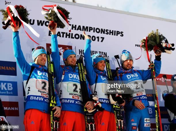 Alexey Volkov Maxim Tsvetkov Anton Babikov and Anton Shipulin of Russia celebrate victory in the Men's 4x 75km relay competition of the IBU World...