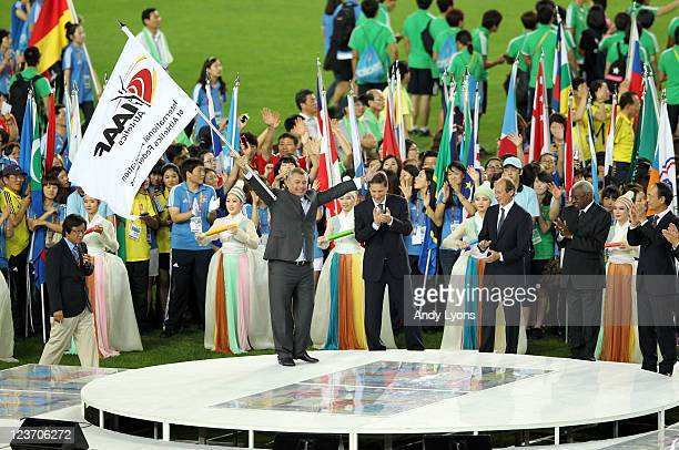 Alexey Vorobiov head of the Moscow Department for Physical Education Sport waves a flag during a handover ceremony between Daegu and Moscow during...