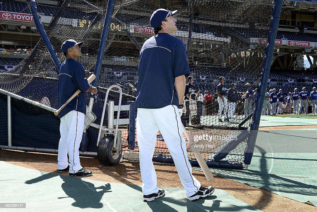 Alexi Amarista and Chris Denorfia of the San Diego Padres wait to hit at the batting cage prior to the game to the game against the Los Angeles...