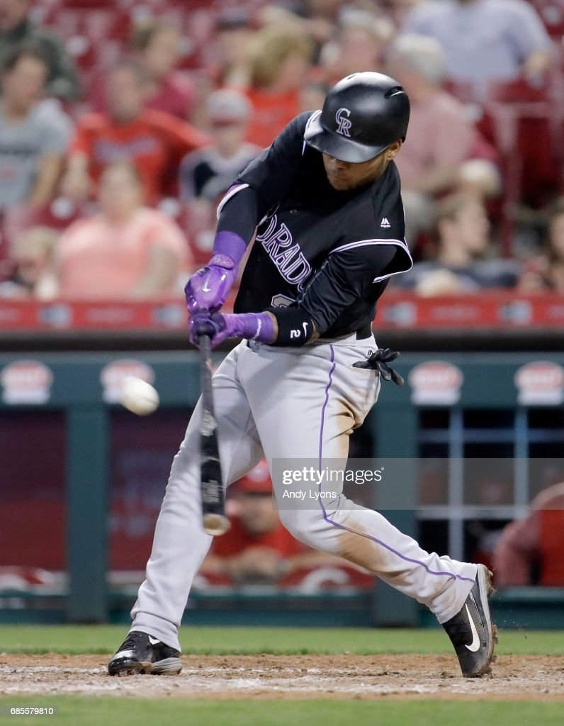 Alexi Amarista #2 of the Colorado Rockies hits the ball in the eighth inning against the Cincinnati Reds at Great American Ball Park on May 19, 2017 in Cincinnati, Ohio.