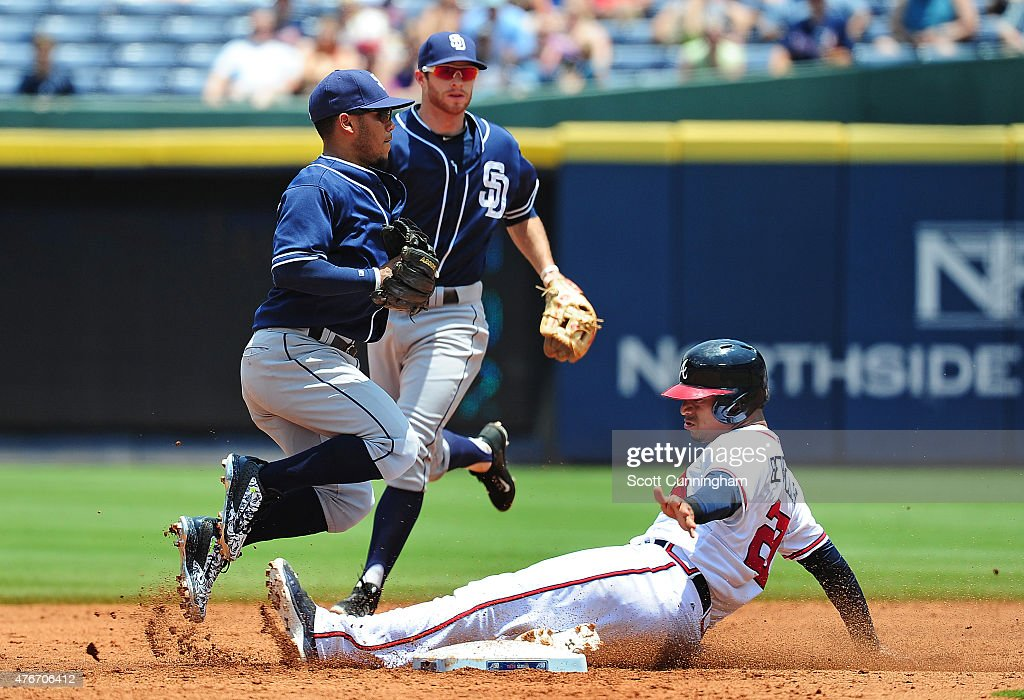 Alexi Amarista of the San Diego Padres attempts to turn a second inning double play against Christian Bethancourt of the Atlanta Braves at Turner...