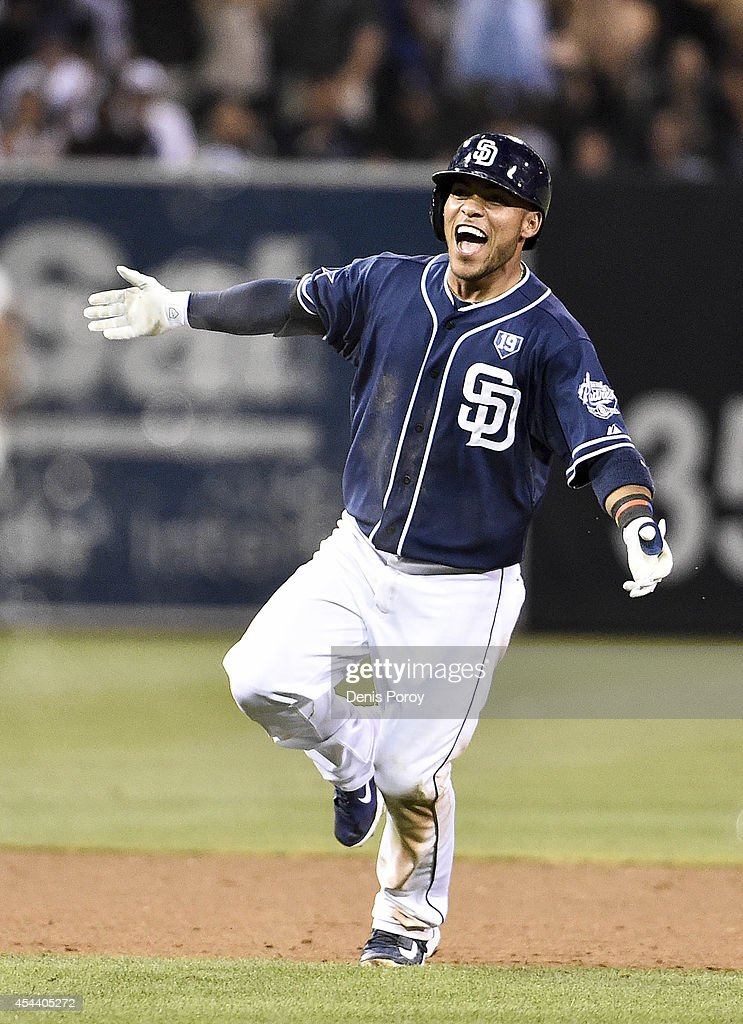 Alexi Amarista of the San Diego Padres celebrates after hitting a walk off single during the tenth inning of a baseball game against the Los Angeles...