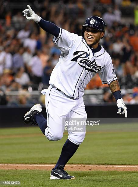 Alexi Amarista of the San Diego Padres celebrates after hitting a walkoff single during the ninth inning of a baseball game against the San Francisco...