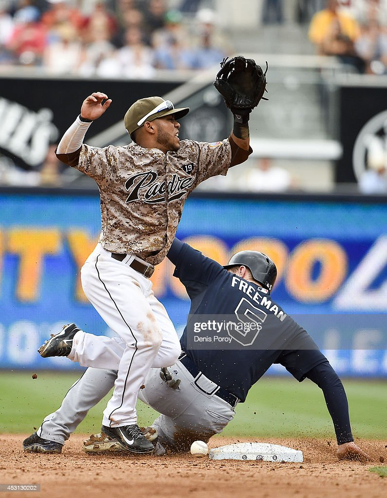 Alexi Amarista #5 of the San Diego Padres drops the ball after getting the force out at second base on Freddie Freeman #5 of the Atlanta Braves during the eighth inning of a baseball game at Petco Park August 3, 2014 in San Diego, California.