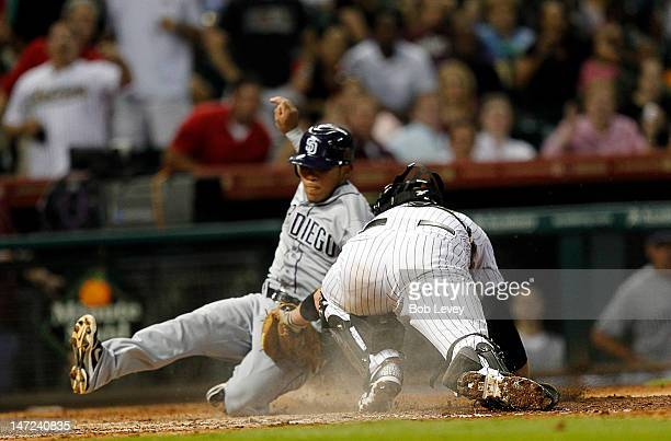 Alexi Amarista of the San Diego Padres is tagged out by catcher Chris Snyder of the Houston Astros in the ninth inning at Minute Maid Park on June 27...