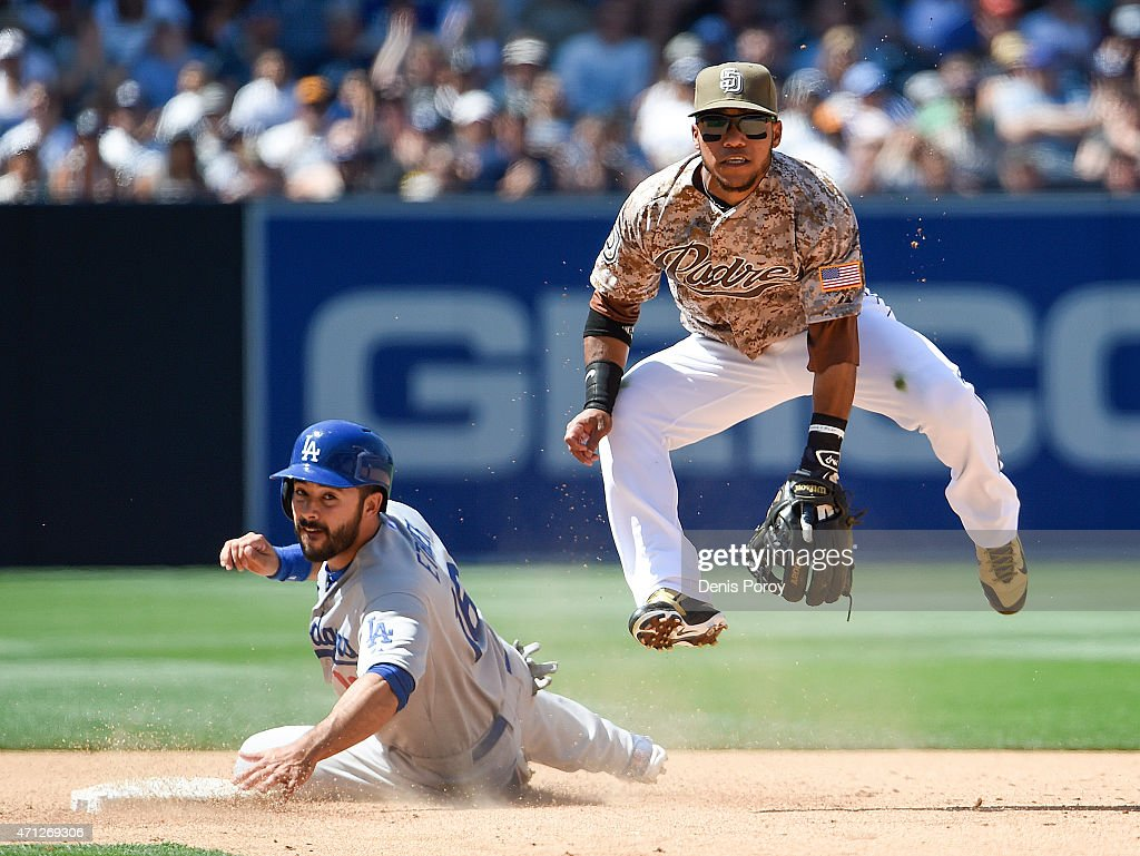 Alexi Amarista of the San Diego Padres jumps over Andre Ethier of the Los Angeles Dodgers as he turns a double play during the sixth inning of a...