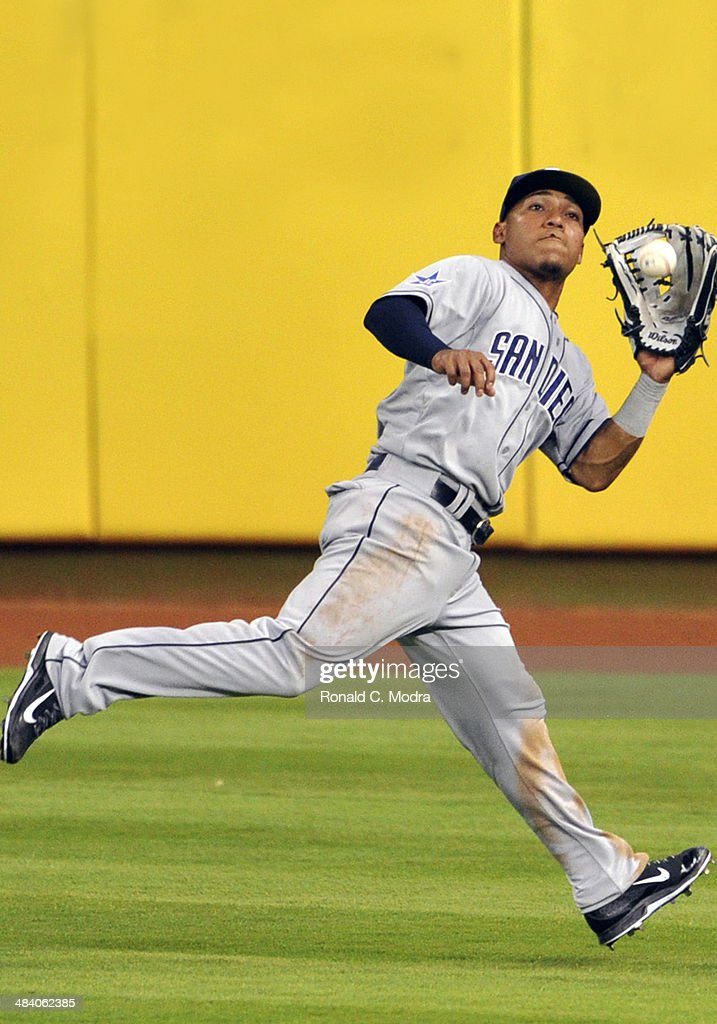Alexi Amarista of the San Diego Padres makes a catch during a MLB game against the Miami Marlins at Marlins Park on April 5 2014 in Miami Florida