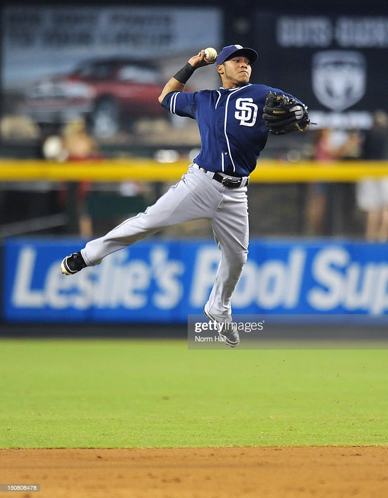 Alexi Amarista of the San Diego Padres makes a leaping throw against the Arizona Diamondbacks at Chase Field on August 26 2012 in Phoenix Arizona