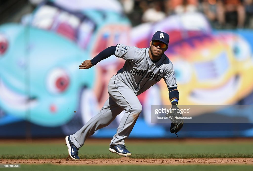 Alexi Amarista of the San Diego Padres reacts to a ground ball hit up the middle against the San Francisco Giants at ATT Park on September 27 2014 in...