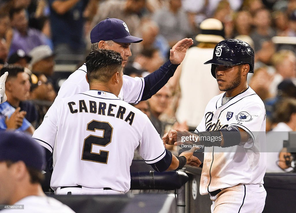 <a gi-track='captionPersonalityLinkClicked' href=/galleries/search?phrase=Alexi+Amarista&family=editorial&specificpeople=6795464 ng-click='$event.stopPropagation()'>Alexi Amarista</a> #5 of the San Diego Padres, right, is congratulated by <a gi-track='captionPersonalityLinkClicked' href=/galleries/search?phrase=Everth+Cabrera&family=editorial&specificpeople=5743470 ng-click='$event.stopPropagation()'>Everth Cabrera</a> #2, and manager <a gi-track='captionPersonalityLinkClicked' href=/galleries/search?phrase=Bud+Black&family=editorial&specificpeople=167104 ng-click='$event.stopPropagation()'>Bud Black</a> #20 after scoring during the third inning of a baseball game against the St. Louis Cardinals at Petco Park July 30, 2014 in San Diego, California.