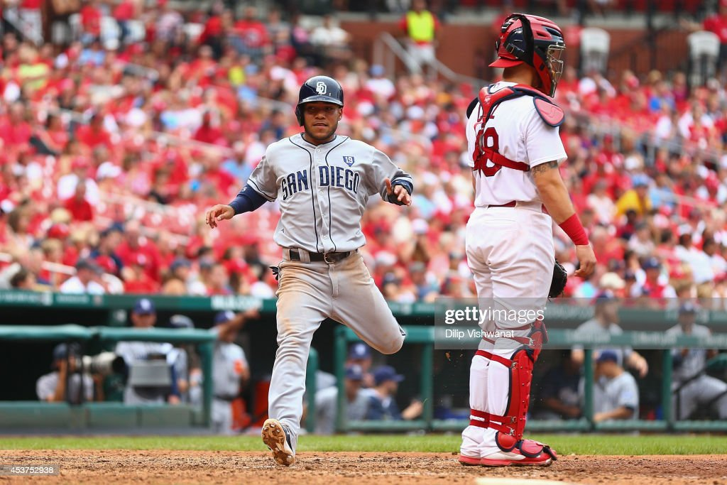 Alexi Amarista #5 of the San Diego Padres scores a run in the ninth inning against the St. Louis Cardinals at Busch Stadium on August 17, 2014 in St. Louis, Missouri. The Cardinals beat the Padres 7-6.