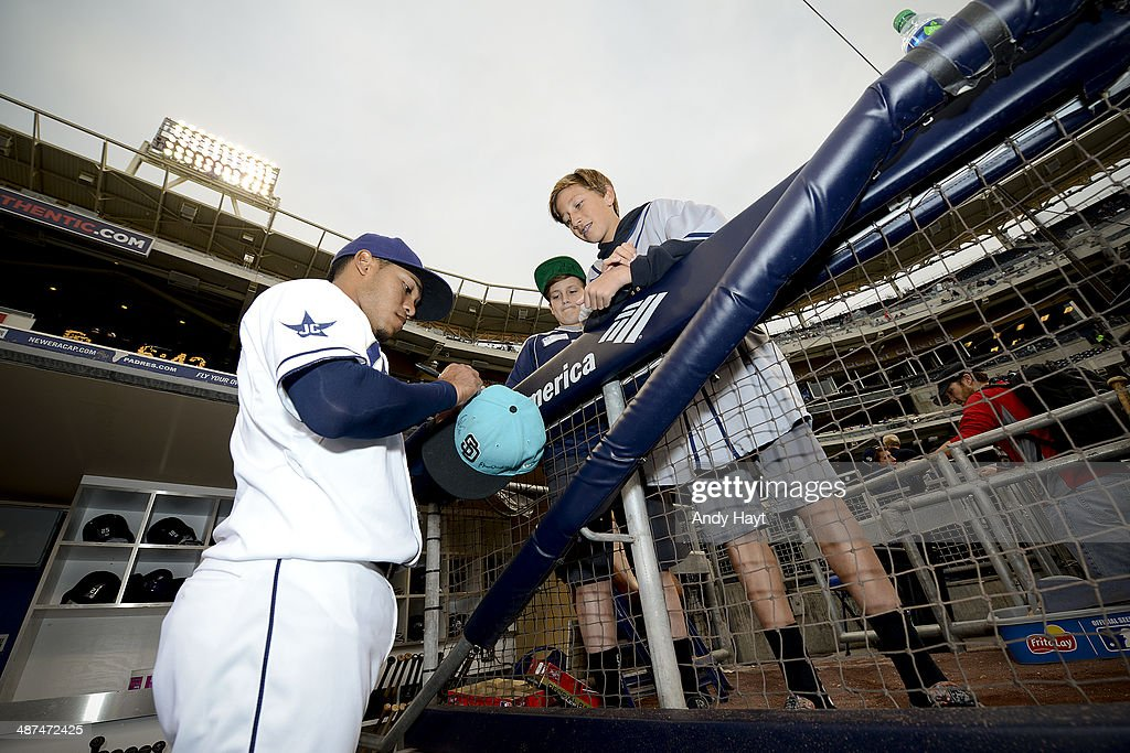 Alexi Amarista of the San Diego Padres signs autographs prior to the game against the San Francisco Giants at Petco Park on April 18 2014 in San...