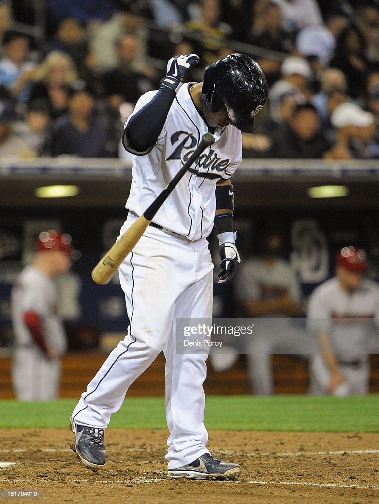 <a gi-track='captionPersonalityLinkClicked' href=/galleries/search?phrase=Alexi+Amarista&family=editorial&specificpeople=6795464 ng-click='$event.stopPropagation()'>Alexi Amarista</a> #5 of the San Diego Padres tosses his bat after striking out during the seventh inning of a baseball game against the Arizona Diamondbacks at Petco Park on September 24, 2013 in San Diego, California.