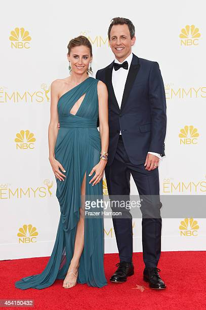 Alexi Ashe and host Seth Meyers attend the 66th Annual Primetime Emmy Awards held at Nokia Theatre LA Live on August 25 2014 in Los Angeles California