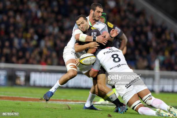 Alexi Bales of La Rochelle between Talalelei Gray of Toulouse and Louis Benoit Madaule of Toulouse during the Top 14 match between Stade Rochelais...