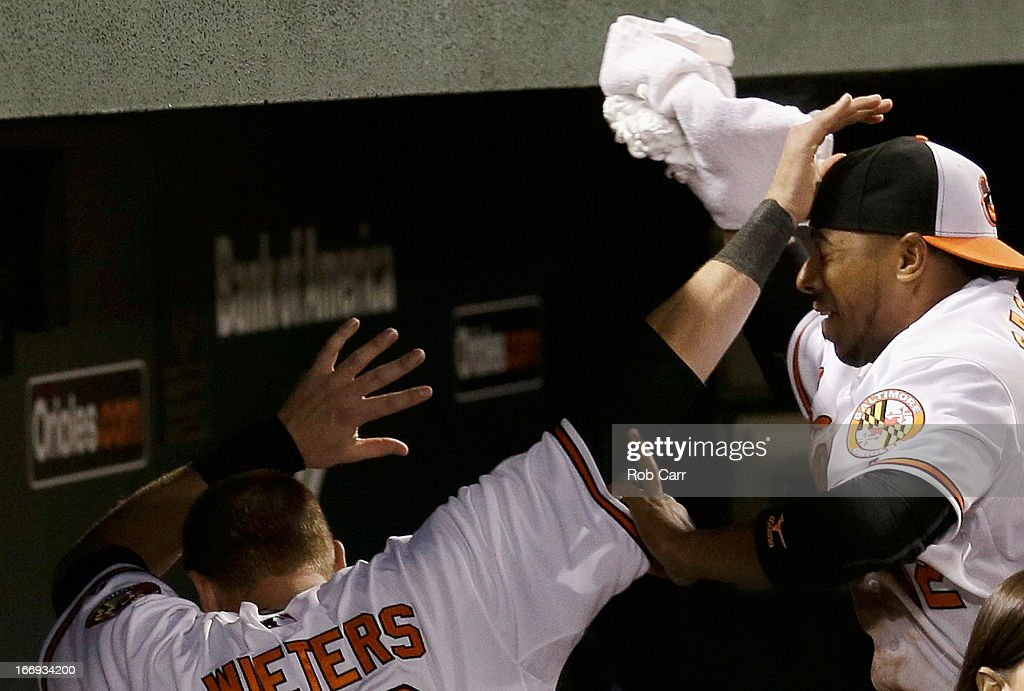 <a gi-track='captionPersonalityLinkClicked' href=/galleries/search?phrase=Alexi+Casilla&family=editorial&specificpeople=4180372 ng-click='$event.stopPropagation()'>Alexi Casilla</a> #12 of the Baltimore Orioles attempts to hit catcher <a gi-track='captionPersonalityLinkClicked' href=/galleries/search?phrase=Matt+Wieters&family=editorial&specificpeople=4498276 ng-click='$event.stopPropagation()'>Matt Wieters</a> #32 of the Baltimore Orioles with a shaving cream pie after Wieters hit a walk off grand slam to give the Orioles a 10-6 win over the Tampa Bay Rays at Oriole Park at Camden Yards on April 18, 2013 in Baltimore, Maryland.
