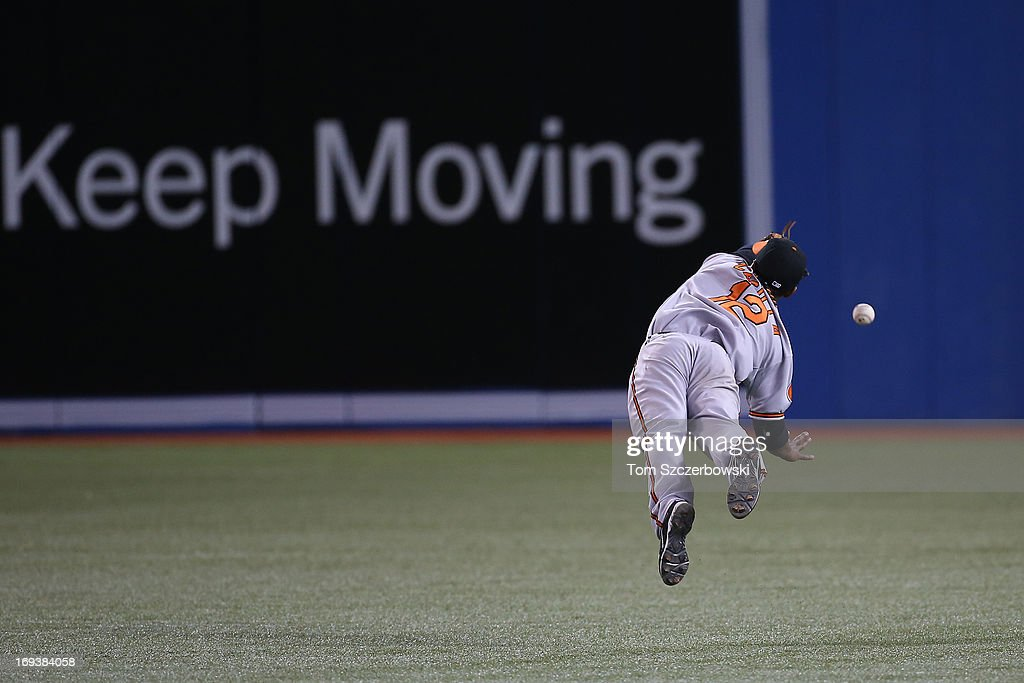 <a gi-track='captionPersonalityLinkClicked' href=/galleries/search?phrase=Alexi+Casilla&family=editorial&specificpeople=4180372 ng-click='$event.stopPropagation()'>Alexi Casilla</a> #12 of the Baltimore Orioles dives but cannot catch a single in the eighth inning by Emilio Bonifacio #1 of the Toronto Blue Jays during MLB game action on May 23, 2013 at Rogers Centre in Toronto, Ontario, Canada.