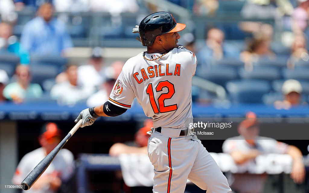 Alexi Casilla #12 of the Baltimore Orioles follows through on a RBI base hit against the New York Yankees at Yankee Stadium on July 6, 2013 in the Bronx borough of New York City. The Yankees defeated the Orioles 5-4.