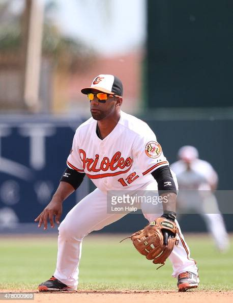 Alexi Casilla of the Baltimore Orioles gets ready to field the ground ball during the spring training game against the Boston Red Sox at Ed Smith...